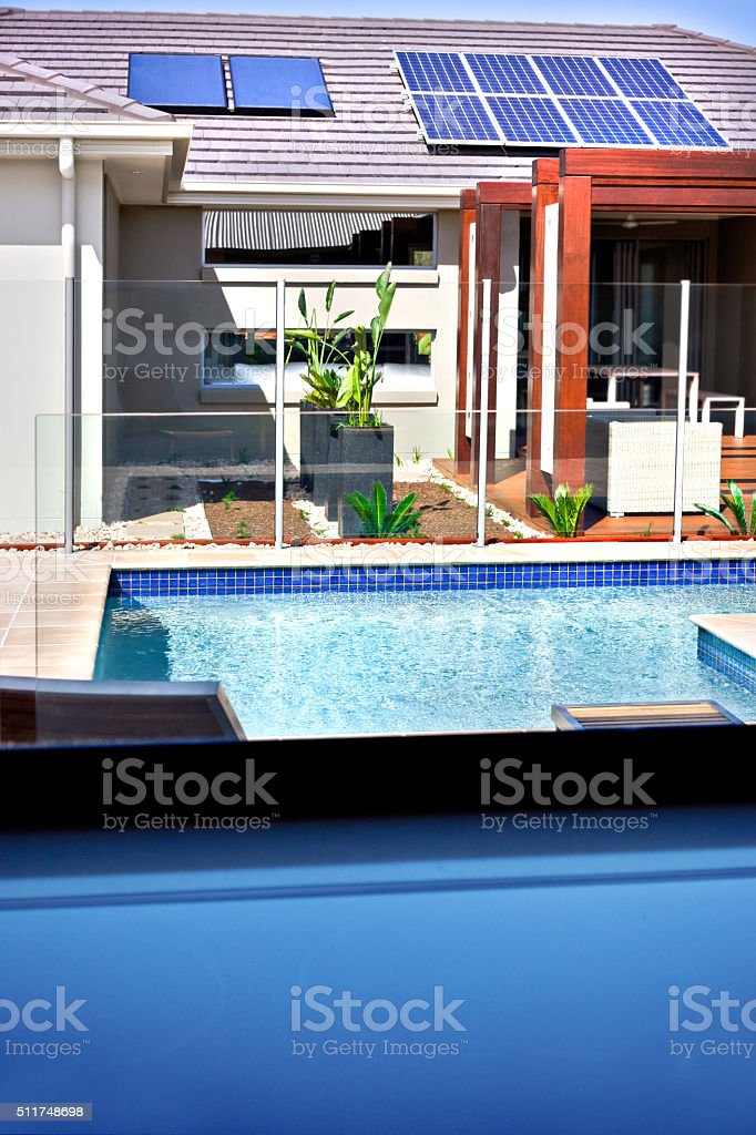 Modern Swimming Pool And A House With Solar Panels Stock ...