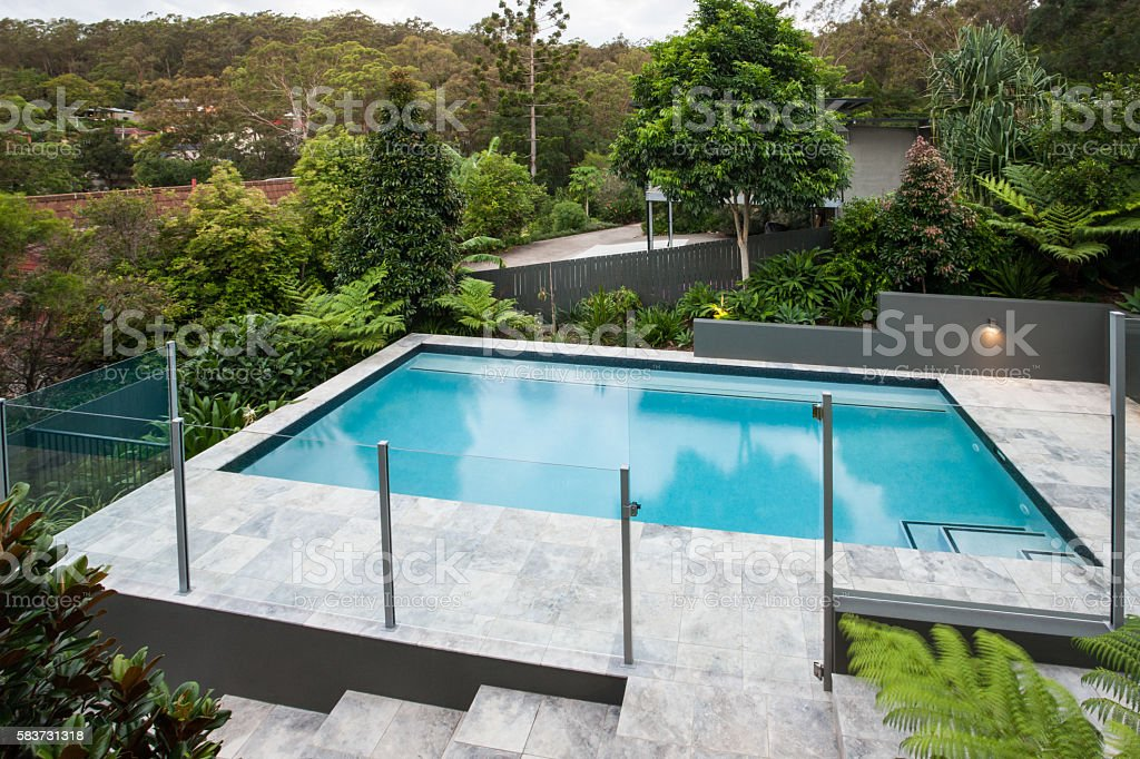 Modern Swimming Pool With A Glass Fence On The Floor Stock Photo Download Image Now Istock