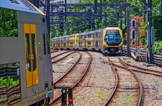 modern sydney trains bi-level millenium services pass at central station - railway signal stock photos and pictures