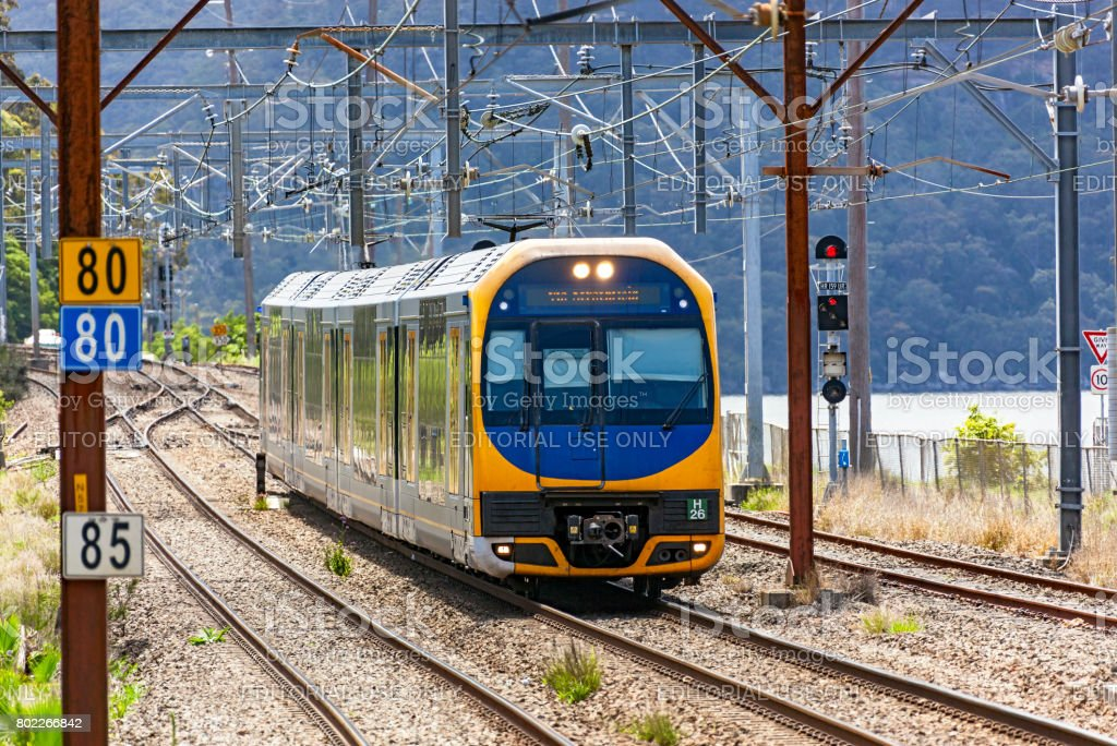 Modern Sydney Trains Oscar Intercity service travelling in rural setting stock photo