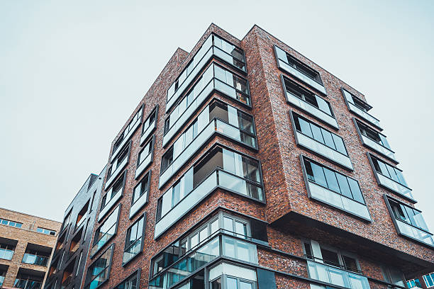 Modern tall brick apartment building stock photo  Corner Of Building Pictures  Images and Stock Photos   iStock. Modern Brick Apartment Building. Home Design Ideas