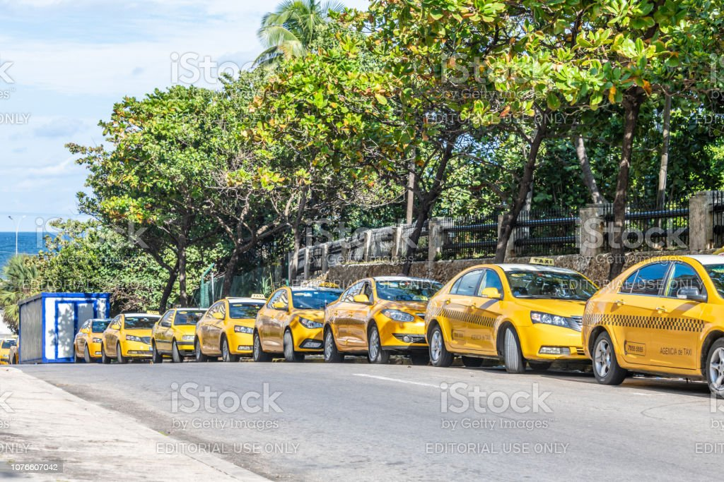 Modern taxis parked on an empty road in Havana, Cuba stock photo
