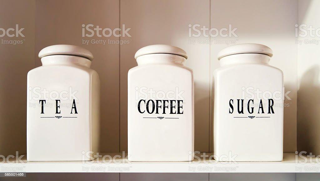 Modern tea coffee and sugar bowl in pantry shelf stock photo