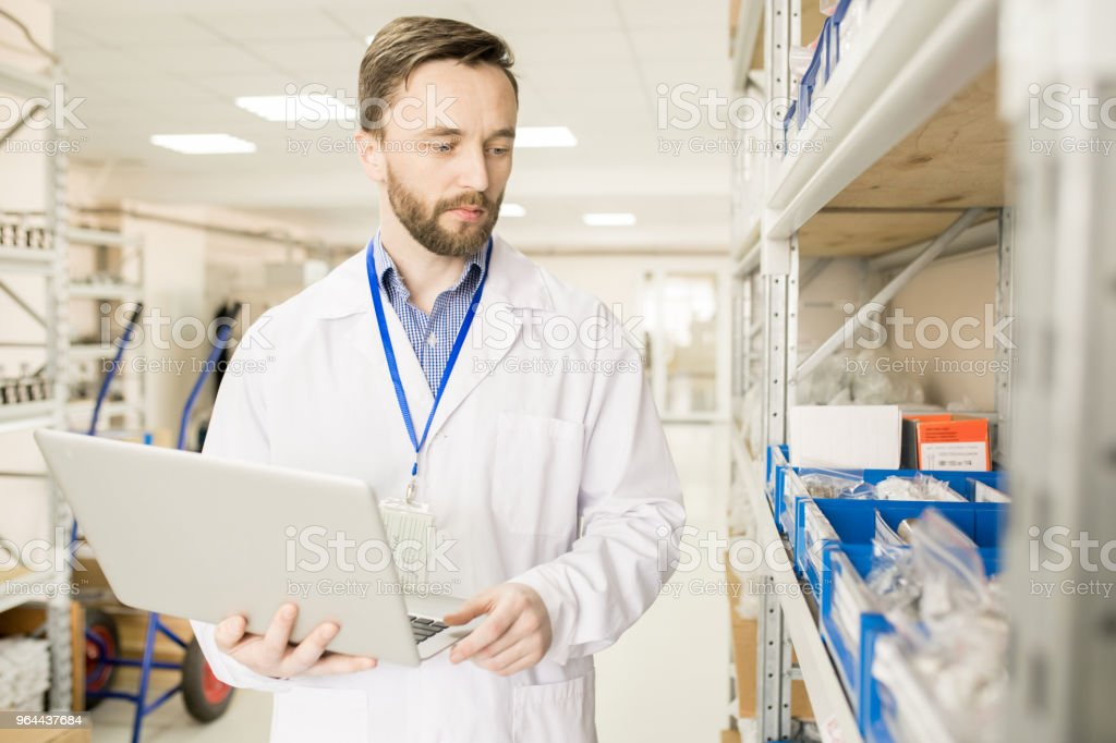 Modern technical engineer preparing goods for export - Royalty-free Adult Stock Photo