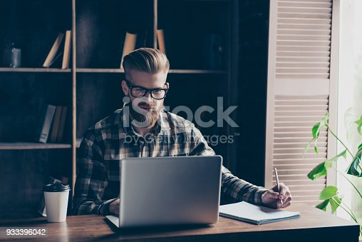 istock Modern technology intelligence casual checkered shirt fashion college campus notebook copybook notepad concept. Portrait of confident concentrated focused clever handsome manager browsing at workplace 933396042
