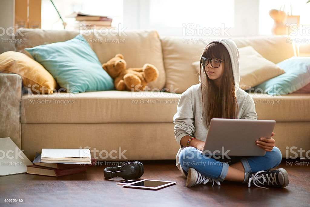 Modern teenager at home stock photo