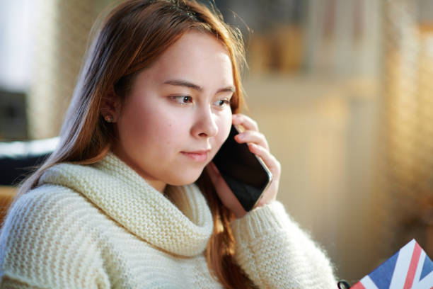 modern teenager girl speaking on cell phone stock photo