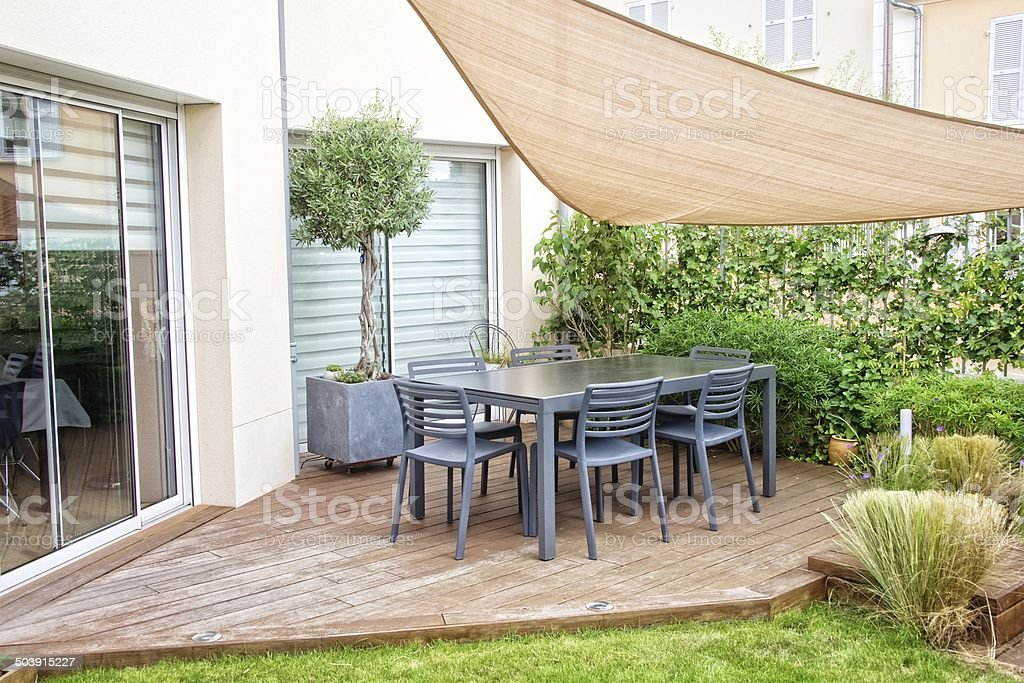 Modern terrace with dining table and chairs stock photo