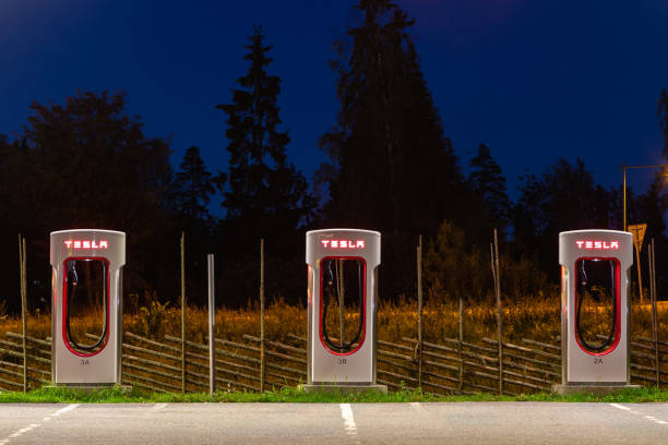 Modern Tesla supercharger at night near Stockholm. Sweden. Stockholm, Sweden - September 13, 2018: Modern Tesla supercharger at night near Stockholm. Sweden. tesla motors stock pictures, royalty-free photos & images