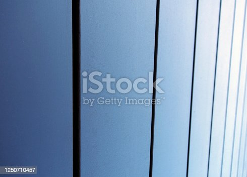 modern textured metallic blue vertical panels architectural abstract background