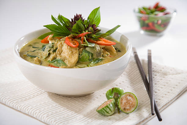 modern thai green curry - thai culture stock photos and pictures