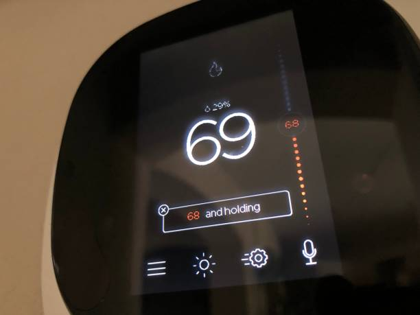 Modern thermostat Modern thermostat smart thermostat stock pictures, royalty-free photos & images