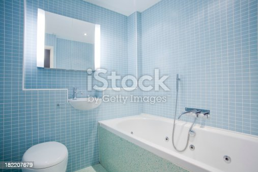 istock Modern tiled bright hot tub bathroom suite 182207679