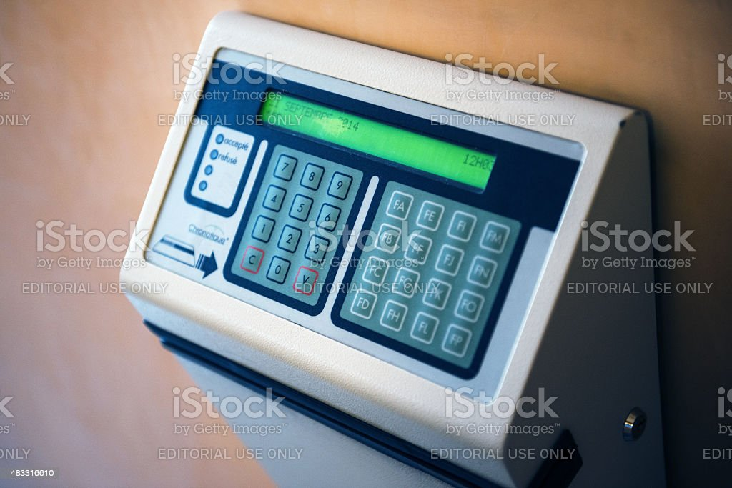 Modern time clock with digital display on wall stock photo