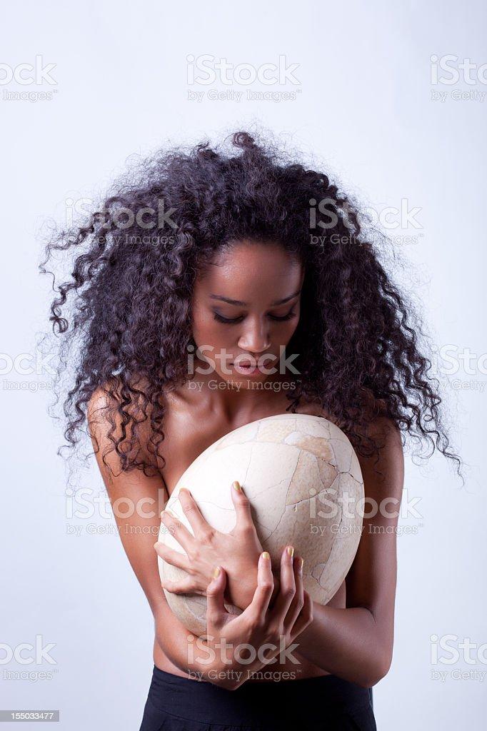 Modern Times: Black Woman Holding Human Egg stock photo