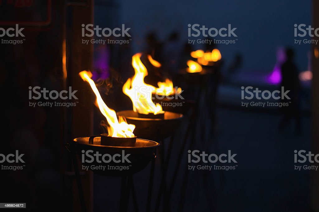 Modern torches in a row at night stock photo
