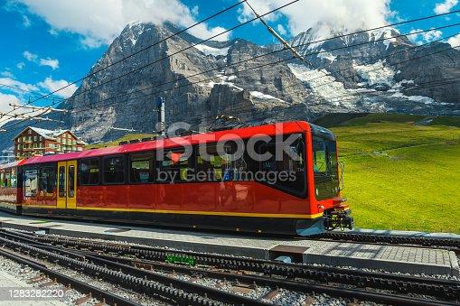istock Modern tourist train in the empty train station, Grindelwald, Switzerland 1283282220