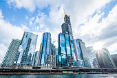 Modern tower buildings or skyscrapers in business district, reflection of cloud on sunny day in Chicago, USA. Advanced construction industry, modern company, or real estate project development concept