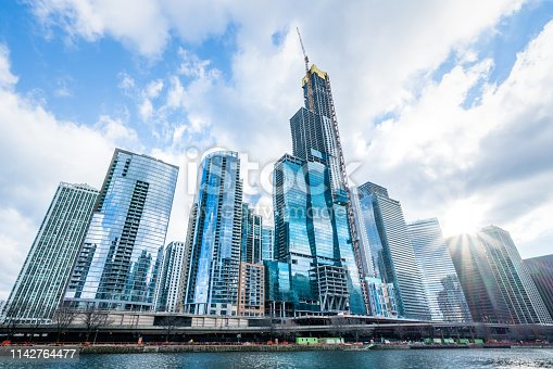 istock Modern tower buildings or skyscrapers in business district, reflection of cloud on sunny day in Chicago, USA. Advanced construction industry, modern company, or real estate project development concept 1142764477