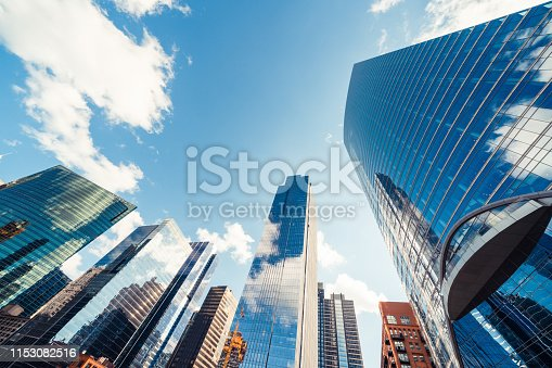 istock Modern tower buildings or skyscrapers in financial district with cloud on sunny day in Chicago, USA. Construction industry, business enterprise organization, or communication technology concept 1153082516