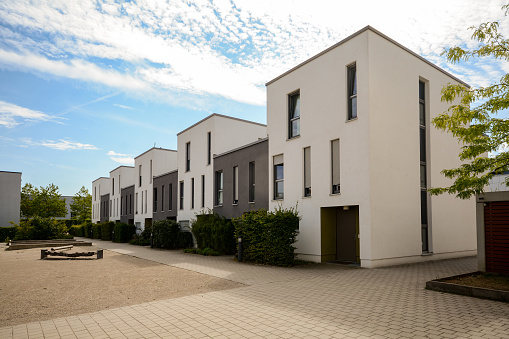 Modern townhouses in a residential area, new apartment buildings with green outdoor facilities in the city