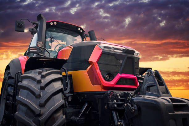 Modern tractor on sunset background stock photo