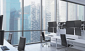 A modern trader's workplaces in a bright modern open space office. White tables equipped with modern trader's stations and black chairs. New York in the panoramic windows. 3D rendering.