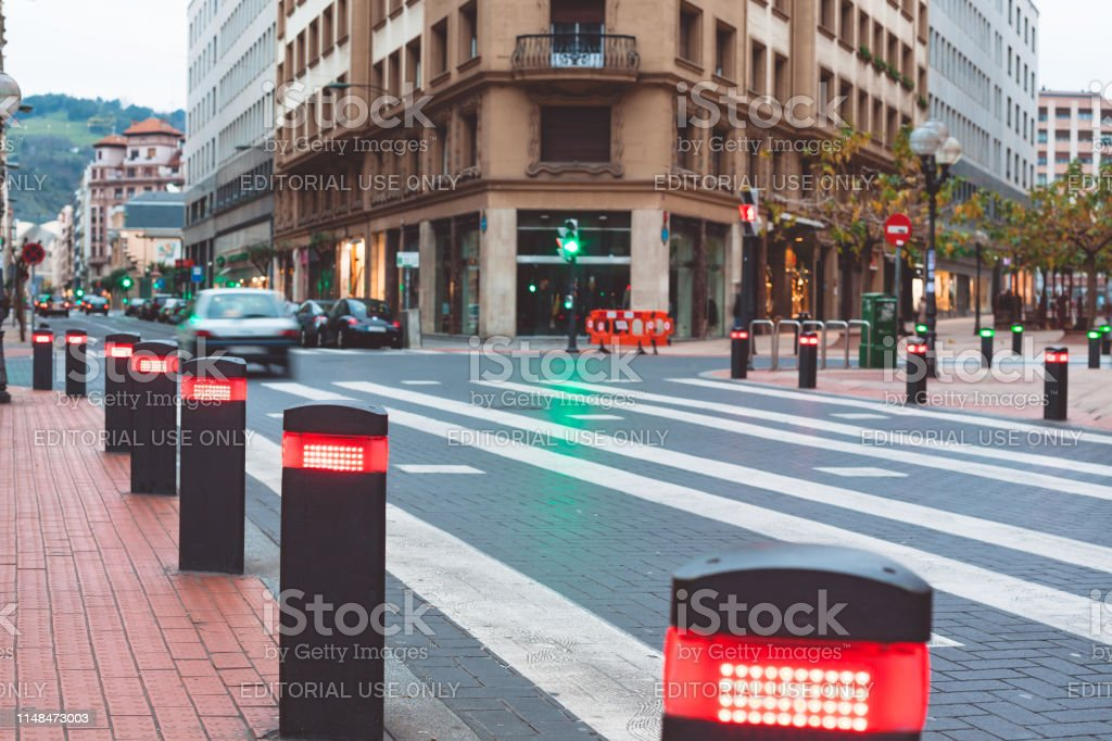 City centre in Bilbao, Spain with modern traffic lights posts on...