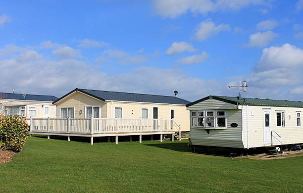 Modern trailer or caravan park Scenic view of modern trailer of caravan park in summer. trailer park stock pictures, royalty-free photos & images