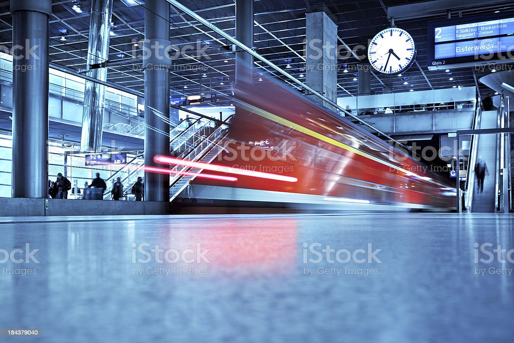 "modern train station ""Train leaving the Station,  motion blurmain railway-station of Berlin - Germany"" Activity Stock Photo"