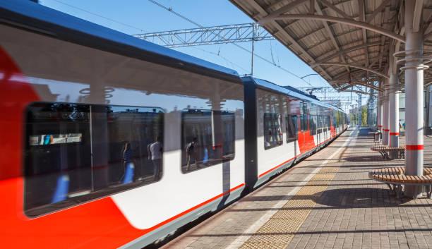 Cтоковое фото Modern train travels past the platform