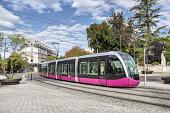 Modern tram on the street of city Dijon, France