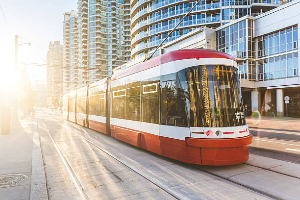 Modern tram in Toronto downtown at sunset stock photo
