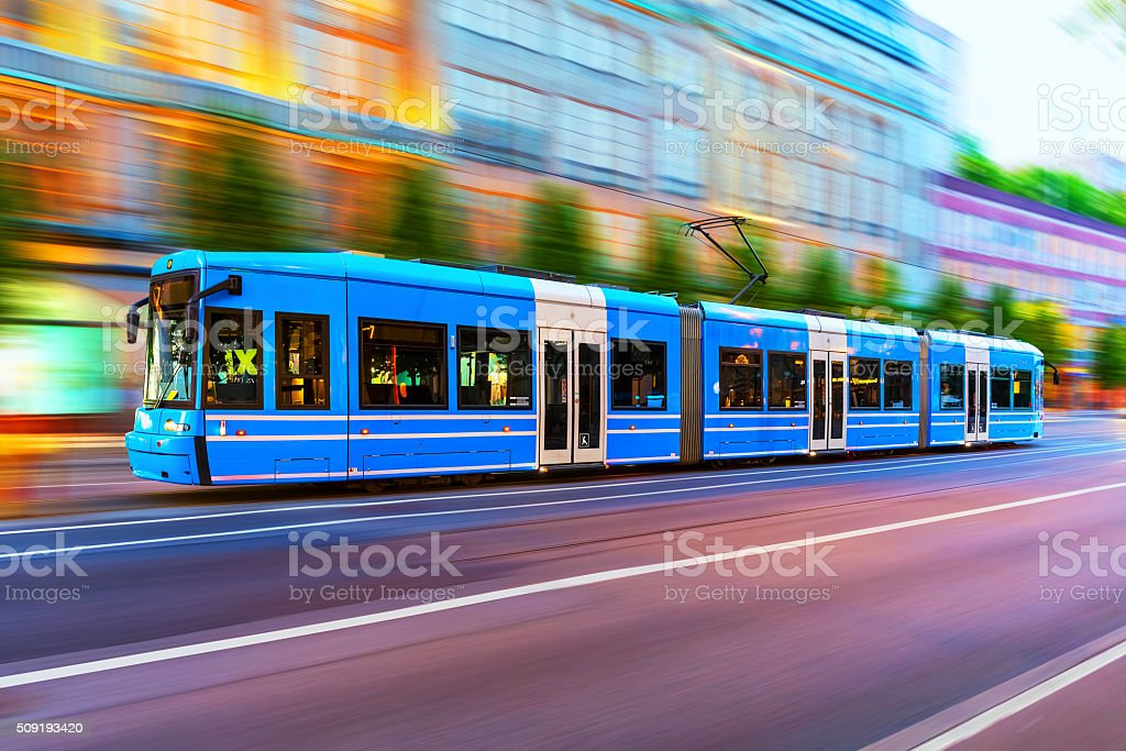 Modern tram on city street in Stockholm, Sweden stock photo
