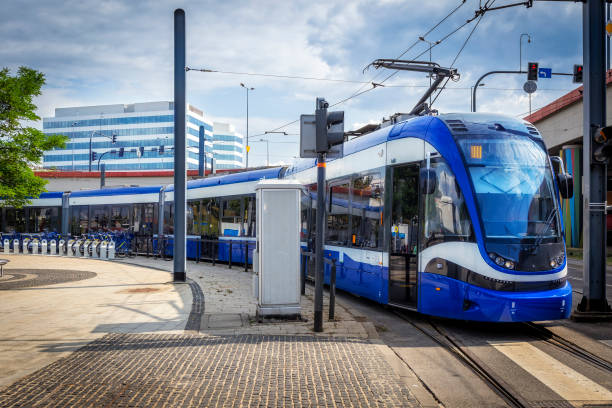 Modern Tram on the platform station, Krakow, Poland Modern Tram on the platform station, Krakow, Poland electric train stock pictures, royalty-free photos & images