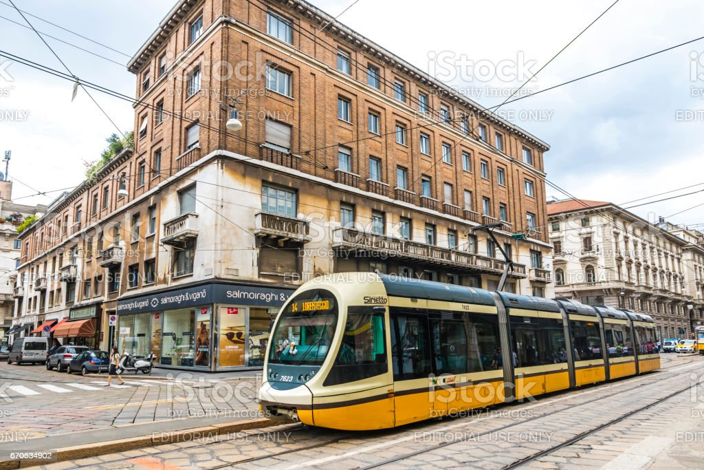 Modern tram on the streets of Milan, Italy - foto stock