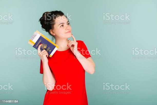 Modern trendy smiling woman in red dress with air tickets and a in picture id1144951184?b=1&k=6&m=1144951184&s=612x612&h=2ww pmyhi583nz63xvbalxyprfq alib80md0y9equo=