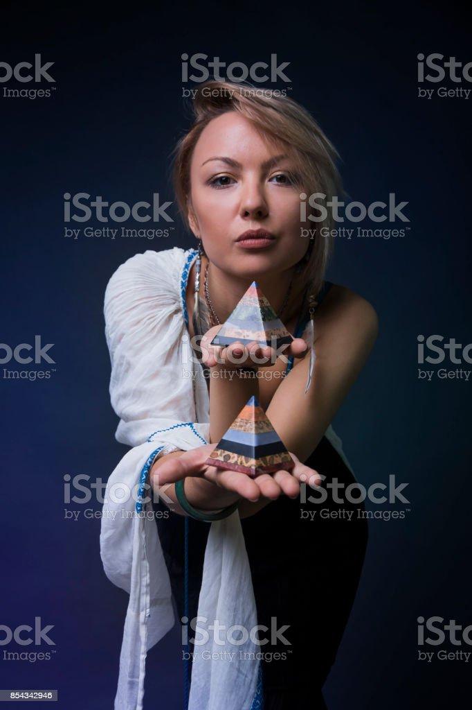 Modern Tribal Gypsy girl holding crystal stock photo