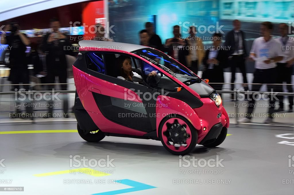 Modern tricycle on the motor show stock photo