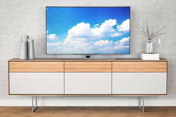 Modern TV Stand TV stand with curved television and modern decors. ultra high definition television stock pictures, royalty-free photos & images