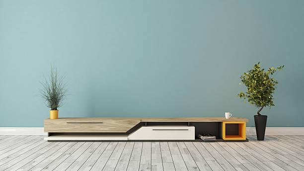 modern tv stand with blue wall design - wohnzimmermöbel holz stock-fotos und bilder