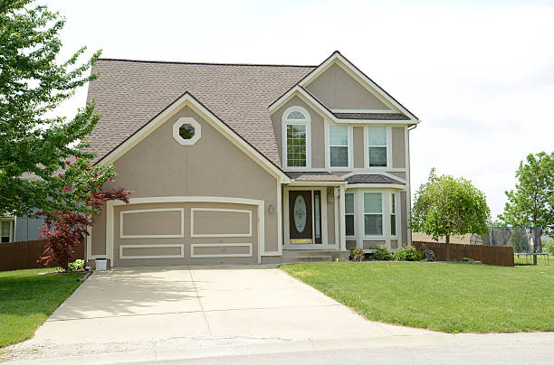 modern two story house with stucco stock photo
