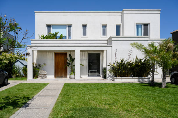 Modern two-story home and front yard in Buenos Aires stock photo