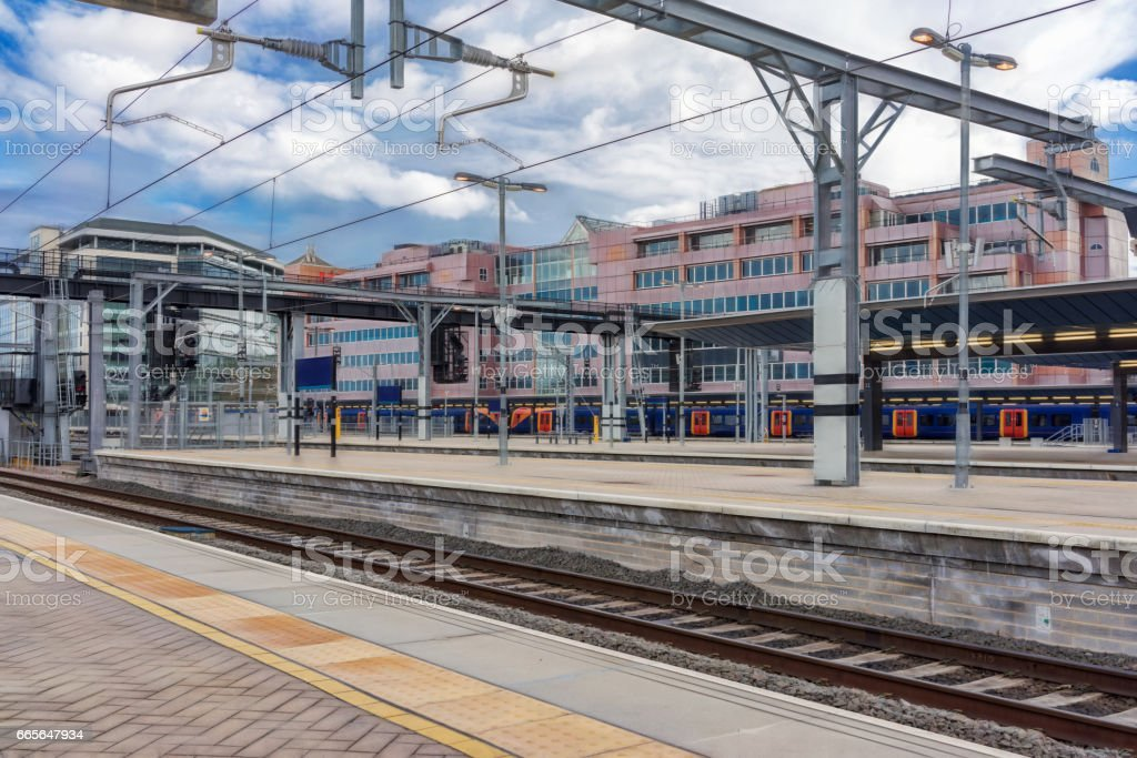 Modern UK station with overhead live wires stock photo
