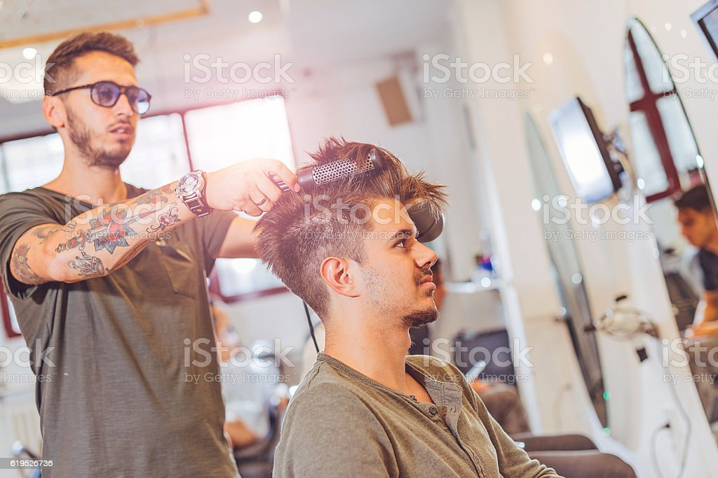 Modern undercut hairstyle for young man stock photo