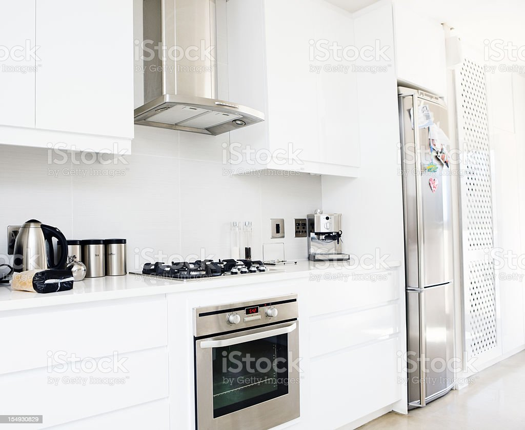 Modern, upmarket, white and stainless steel domestic kitchen stock photo