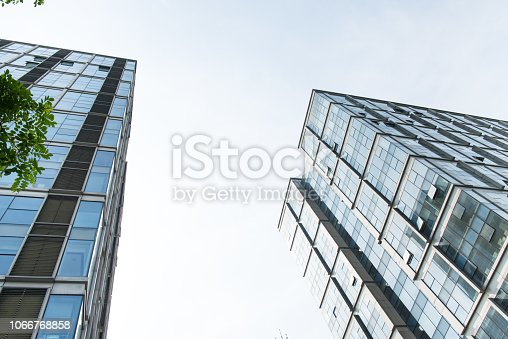 638467106istockphoto Modern urban architecture and sky 1066768858