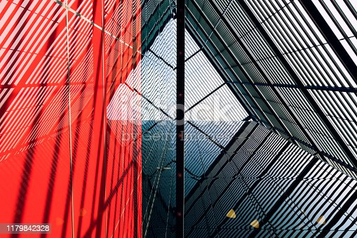 Internal steel structure of modern car park, public building, red and black colors