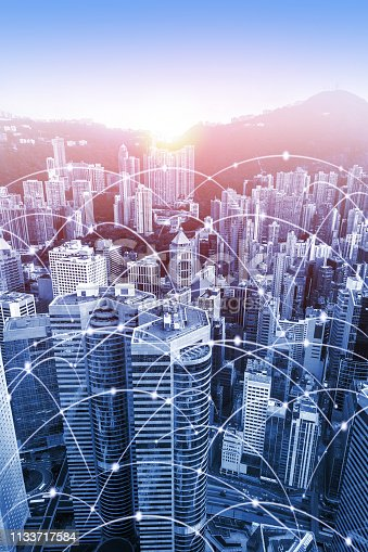 Modern urban skyline with high-speed data and internet communication network. Concept of cyber network in big city with copy space. Vertical orientation.