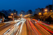 Beijing at night ,China.Modern urban landscape and the bustling streets in the evening Modern urban landscape and the bustling streets in the eveningTram in traffic city Busy night traffic in Hong Kongtraffic in